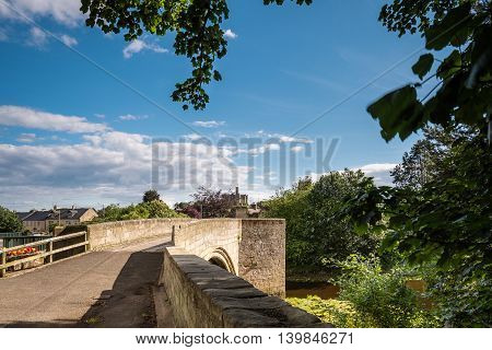 Warkworth Old Bridge, is medieval and one of just two fortified bridges in Briton, with the castle on the skyline