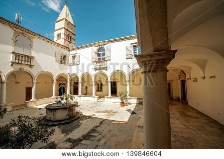 Courtyard of Minorite monastery of St. Francis in Piran city in Slovenia