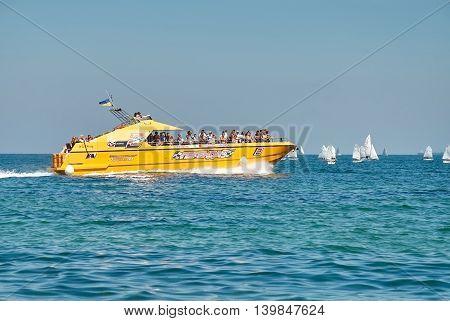 Orange Pleasure Boat With People On The Black Sea