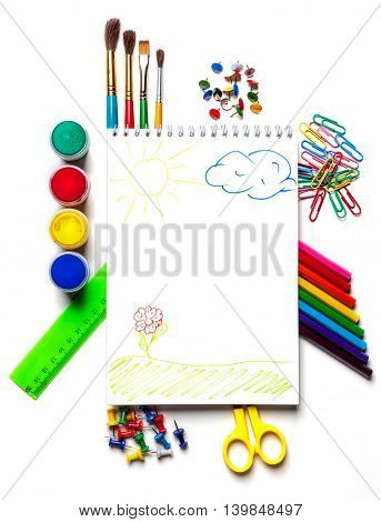 School and art supplies laid out on a white background isolated. Stationery with the top view. Back to school concept