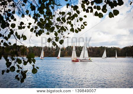 Trakai Lithuania - October 15 2011: Sailing ship yachts with white sails during annual regatta on Galve lake on 15 October 2011 inTrakai Lithuania.