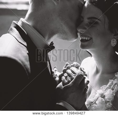 Bride and groom posing in a room with a close angle