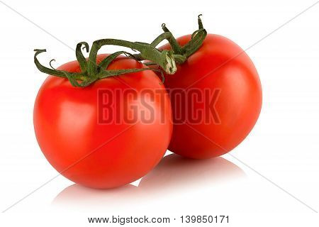 two red ripe tomato on a white background.
