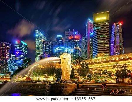 Skyscrapers And Merlion Statue At Merlion Park Night