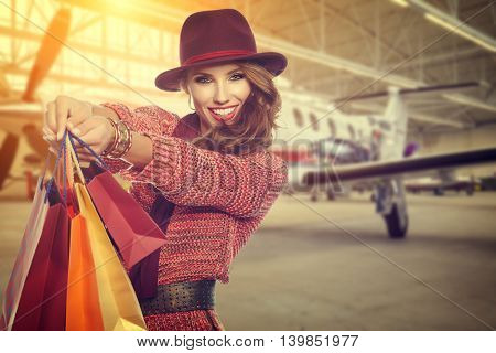 Woman after shopping in airport