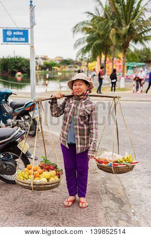 Asian Seller Carrying Rambutan Mango Banana And Mandarin