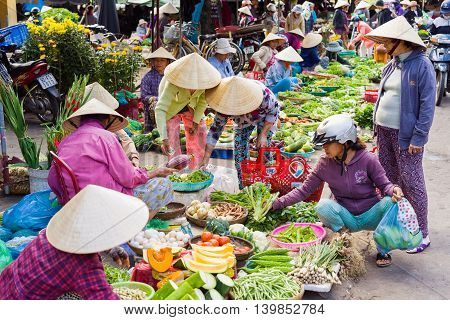 Asian Traders Selling Fresh Vegetables In The Street Market