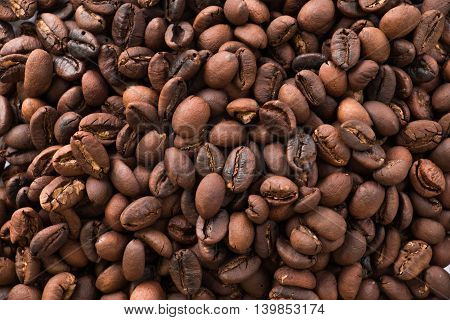 Close up roasted coffee beans on  background