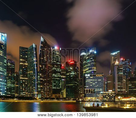 Singapore Skyline On Downtown Core At Marina Bay At Dusk