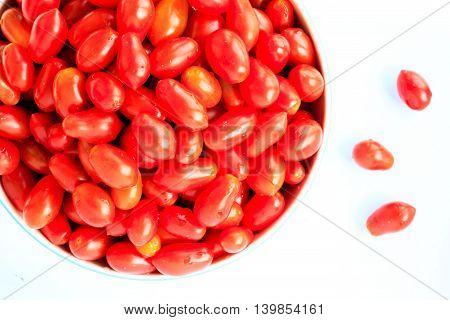 Group of cherry tomatoes isolated on white background