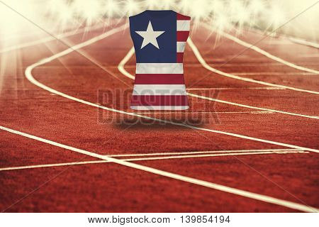 Red Running Track With Lines And Liberia Flag On Shirt