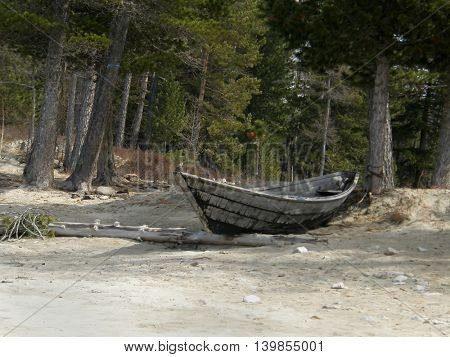 Boat on the shore of Lake Baikal. Buryatia. Siberia. Russia
