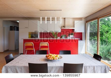 Interior of an eco house, dining table and kitchen