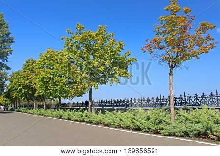 KYIV, UKRAINE - SEPTEMBER 14, 2014: Promenade near the Kyiv Sea in Mezhyhirya - former residence of ex-president Yanukovich, now open to the public, Kyiv region, Ukraine