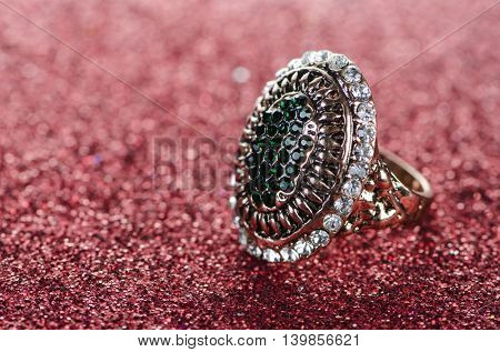 Jewellery ring against shiny background