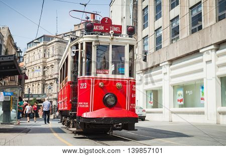 Old Red Tram Goes On Istiklal Street In Istanbul