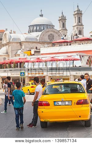 Pedestrians And Taxi Drivers Are On Taksim Square