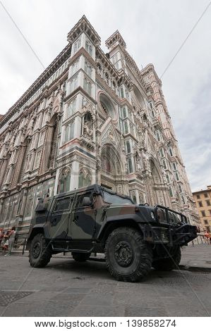 Army vehicle in front of the Duomo in Florence, Italy, July 2016