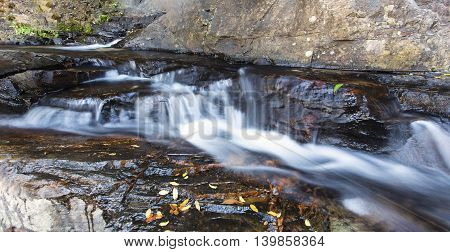 Small waterfall landscape with long exposure high in river