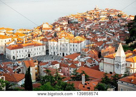 Aerial city scape view on Piran town with Tartini main square and Adriatic sea on the background in Slovenia