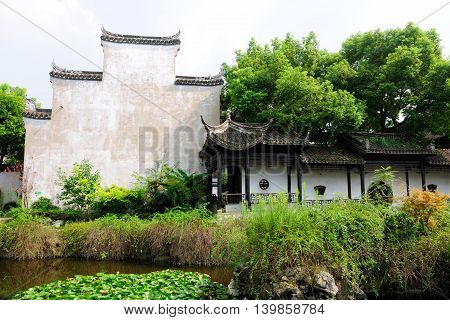 A weathered building and Chinese garden in Fengjing Town in Shanghai China.
