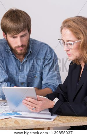 Shot of a mother explaining her design ideas to her son