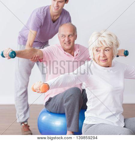 Positive Seniors At Fitness Studio