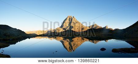 Midi Dossau Peak reflected in Miey lake. Ossau Valley, Pyrenees National Park, Pyrenees, France.