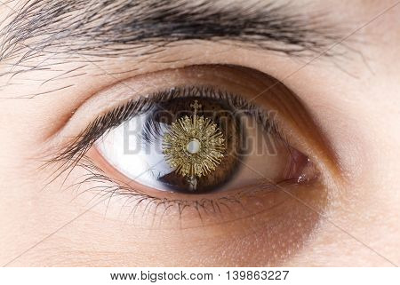 A Catholic priest santisimo host at Communion. Eye looking Jesus Eucharist