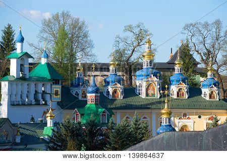 Belfry and domes of the assumption Cathedral of the Holy Dormition Pskovo-Pechersky monastery. Pechory, Russia