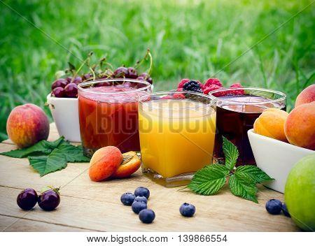 Fruit juice - healthy drinks (beverage) on rustic wooden table