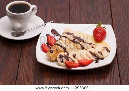 Crepes with Banana, Chocolate and strawberries with cup of coffee
