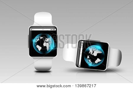 modern technology, object, network, responsive design and communication concept - smart watches with earth globe on screen over gray background