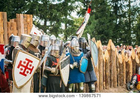 Dudutki, Belarus - July19, 2014: Historical restoration of knightly fights on festival of medieval culture. The siege of wooden fortress