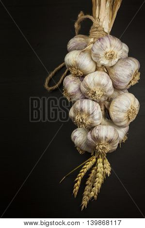 Garlic braid. Healthy food. Sales of garlic.