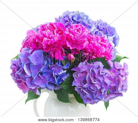 Bright pink peony, eustoma and blue hortensia fresh flowers bouquet close up isolated on white background