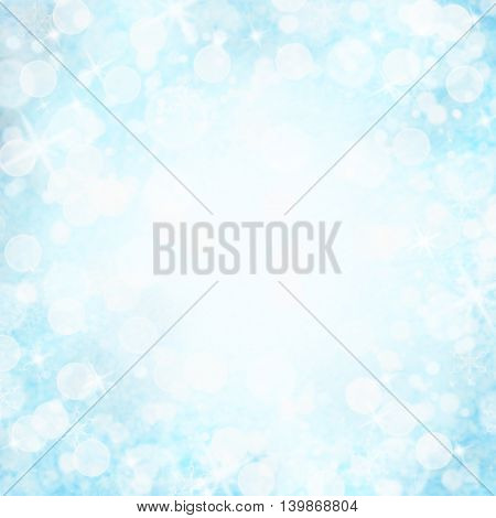 Abstract background of blue bokeh holiday lights with copy space.