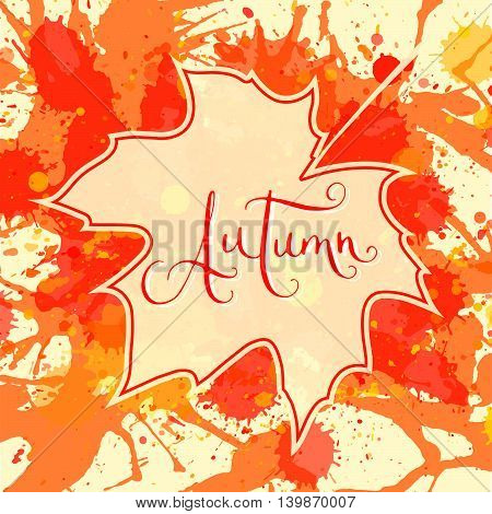 Word Autumn hand written over maple leaf on a bright orange artistic paint splatter background. Contemporary calligraphy.
