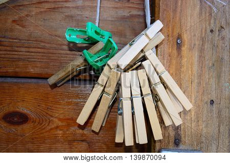 old wooden and plastic clothespegs on a rope opposite to a wooden door