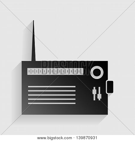 Radio sign illustration. Black paper with shadow on gray background.