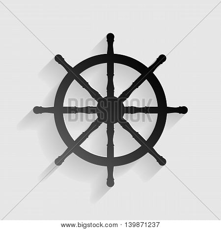 Ship wheel sign. Black paper with shadow on gray background.