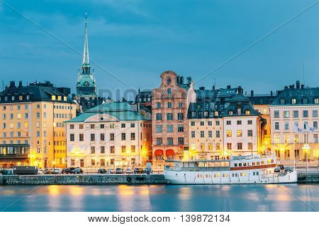 Scenic View Of Embankment In Old Part Of Stockholm At Summer Evening, Sweden. Time After Sunset. Dusk