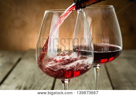 Pouring wine in a glass, copy space