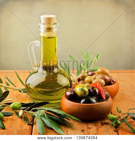 Marinated olives with oil in wooden plates