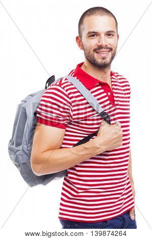 Happy smiling male student standing with backpack on white background