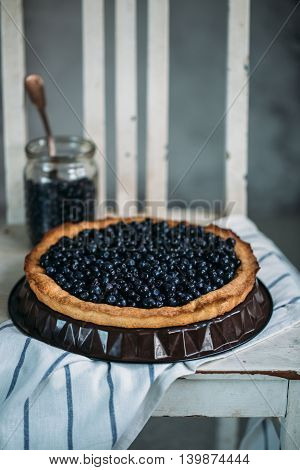 Fresh baked blueberry pie on a old chair