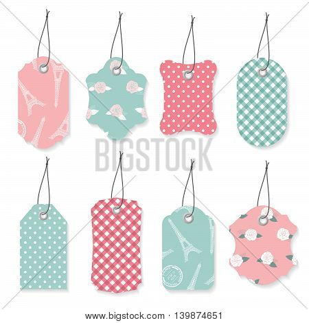 Cute textile label tags set in pastel blue and pink colors.