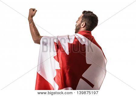 Athlete celebrating and holding the flag of Canada