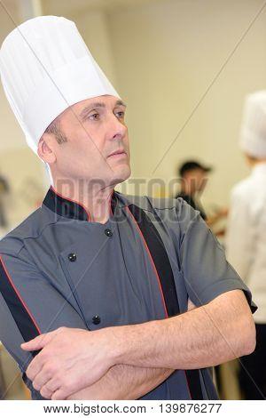 portait of attractive male chef in restaurant kitchen