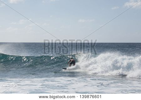 North Shore, Oahu, Hawaii - October 20: Surfer Rips wave on the north shore.